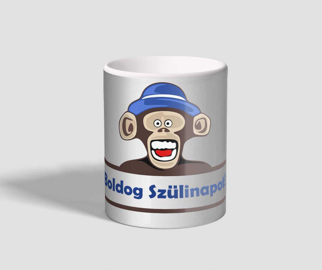 Boldog szülinapot feliratú, vigyorgó majmos bögre