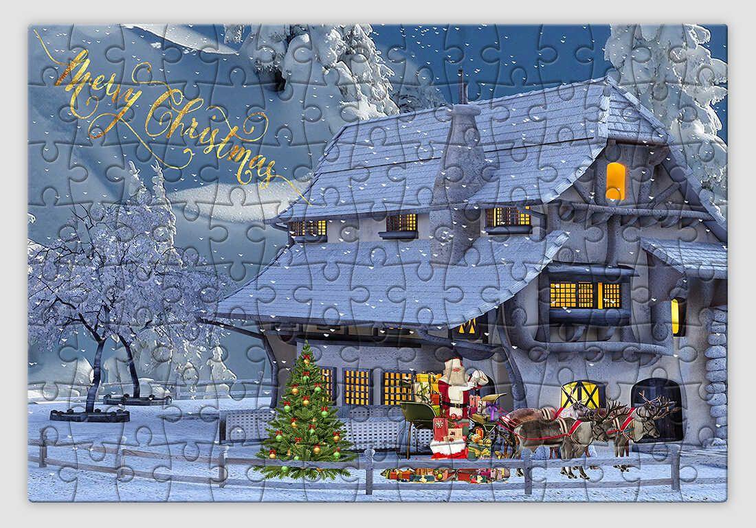Havas hegyoldalban lévő házikót ábrázoló karácsonyi kirakó